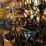 "Tanya's basement filled to the brim with 10 ""visiting"" bikes."